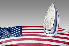 Preparing to smooth out the wrinkles of Flag-USA Royalty Free Stock Photography