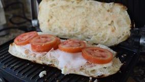 preparing toasted stuffed sandwich stock video footage