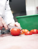 Preparing tomato for salad Stock Photography