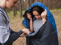 Preparing tourist sleeping bag together concept. Stock Images