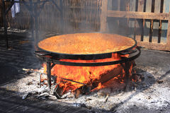 Preparing Traditional, big Paella on the beach. Preparing big paella on the traditional way with all kinds of sea food and rice, Andalusia beach Spain Stock Photography