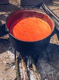 Preparing traditional romanian tomato juice/sause in caldron, bo. Iled and preserved for the winter in a jar stock photo