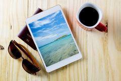 Preparing for travel sea on screen at tablet. On table Stock Images