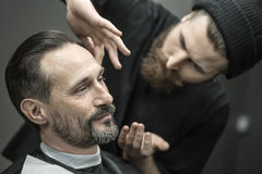 Preparing for trimming in barbershop Royalty Free Stock Images