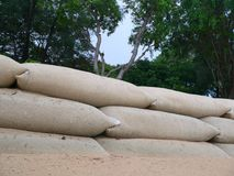 Preparing for the tsunami. A wall of sandbags at the seaside royalty free stock image