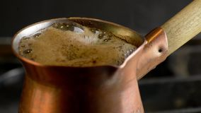 Preparing turkish coffee in copper cezve on gas stove. Cooking turkish coffee in copper cezve on gas stove stock video