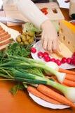 Preparing vegetable sandwiches Stock Photography