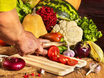 Preparing vegetable on wooden boards. Stock Photos