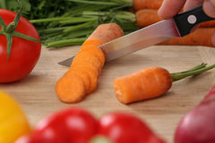Preparing vegetables food sliced carrot on a kitchen board Stock Images