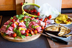 Preparing vegetables and meat  in kitchen board Stock Images