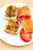 Preparing vegetarian sandwiches with pickle muffaletta, tomatoes Royalty Free Stock Images