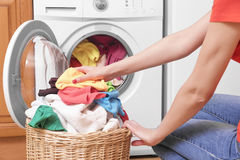 Preparing the wash cycle. Washing machine, hands and clothes stock photography