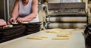 Preparing dough in a bakery. Preparing and weighing dough in a large bakery Royalty Free Stock Image