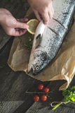 Preparing whole salmon fish for cooking Stock Image