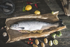 Preparing whole salmon fish for cooking Royalty Free Stock Photo