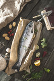 Preparing whole salmon fish for cooking Royalty Free Stock Images