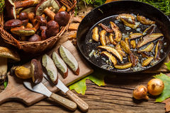 Preparing wild mushrooms to frying Stock Photo