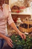 Preparing xmas wreath Royalty Free Stock Images