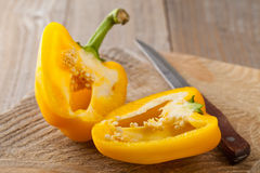 Preparing a yellow bell pepper on kitchen table Stock Photos