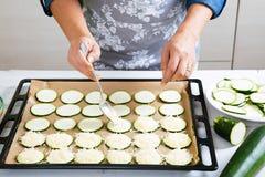 Preparing zucchini with cheese to bake Stock Photo