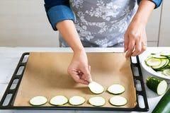 Preparing zucchini to bake Stock Images