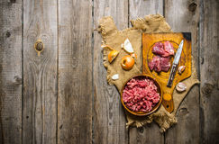 Prepatared of meat. The preparation of minced meat and onions on the old fabric. Stock Photos