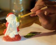 Prepating para Chrismas Adornamiento de Santa Claus Imágenes de archivo libres de regalías