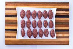 Prepped Ready to Cook Turkish Meat Balls on a wooden Board Royalty Free Stock Images