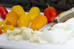 Prepping for Dinner. Peppers, onions and garlic being prepped for a dinner recipe Stock Image