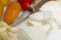 Prepping for Dinner. Peppers, onions and garlic being prepped for a dinner recipe Royalty Free Stock Photo