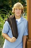 Preppy Portrait. Young blond teenage boy posing for his senior portrait royalty free stock images