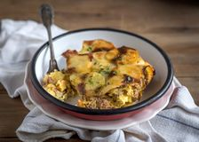 Prepred and served traditional Greek moussaka. Prepred traditional Greek moussaka with potatoes served in the plate,selective focus Royalty Free Stock Photos