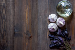 Prepring for cooking dinner. Garlic, basil and oil on wooden table background top view copyspace Stock Images