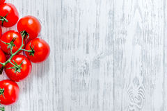 Prepring for cooking dinner. Tomato on wooden table background top view copyspace Royalty Free Stock Images