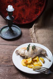 Prerared rabbit meat with potato on a rustic style background. S Stock Photography