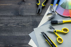 Preraring for repair. Paint and tools on wooden desk background top view copyspace.  royalty free stock images