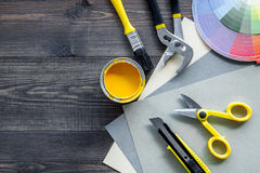Preraring for repair. Paint and tools on wooden desk background top view copyspace.  stock photo