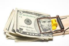 Presa dei soldi Fotografie Stock