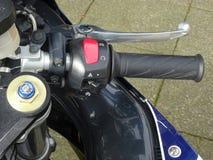 Presa del comando del motociclo Fotografia Stock
