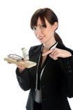 Presa del mouse della holding della donna di affari con soldi Fotografie Stock Libere da Diritti