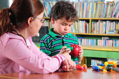 Preschool. Teacher with her preschooler in a classroom Stock Image