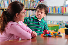 Preschool. Teacher with her preschooler in a classroom Stock Photography