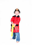 Preschool age boy in fireman costume. With hose on white background Royalty Free Stock Photo