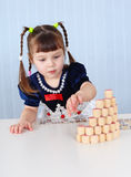 Preschool-age girl playing with Lotto Royalty Free Stock Photo