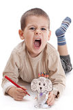 Preschool aged boy drawing Royalty Free Stock Images
