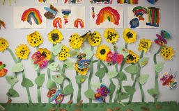 Preschool Art. Art projects on display in a preschool classroom depict sunflowers and rainbows Royalty Free Stock Photography