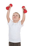 Preschool boy does morning exercises Stock Photo