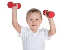 Preschool boy with dumbbells Stock Images