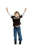 Preschool boy jumping in the air Stock Images