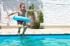 Preschool boy are jumping to the  pool Royalty Free Stock Photos